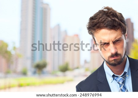 young crazy businessman angry face - stock photo