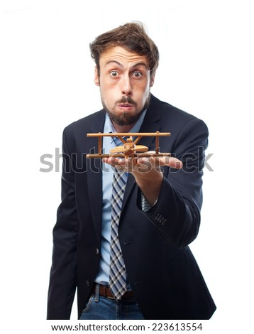 young crazy businessman wooden plane