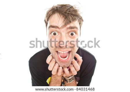 young crazy guy looks into the camera, isolated over white
