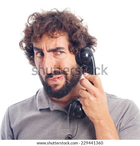 young crazy man doubting at phone - stock photo