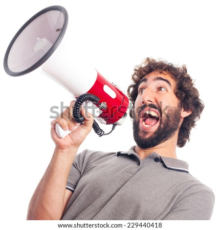 young crazy man shouting with a megaphone - stock photo
