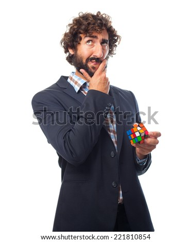 young crazy man solving a challenge - stock photo