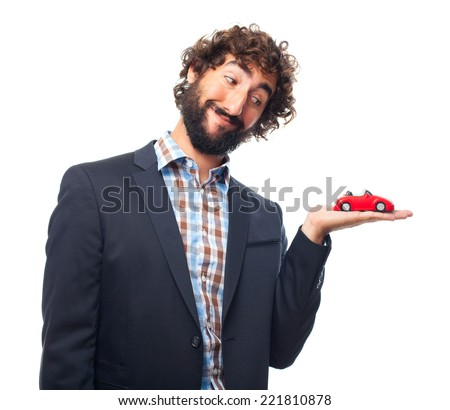 young crazy man with a car toy - stock photo