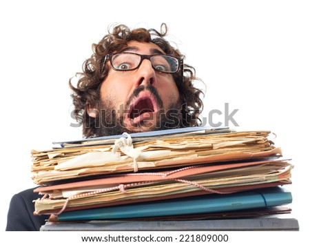 young crazy man with papers y books - stock photo