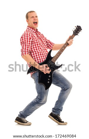 Young, crazy musician with electric guitar - stock photo