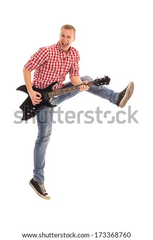 Young, crazy musician with electric guitar