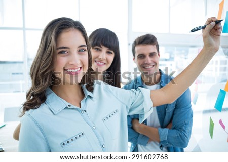 Young creative business people writing photo editor at office
