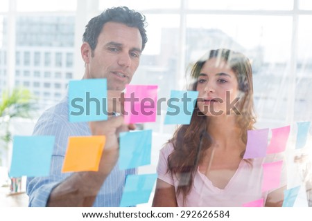 Young creative business people writing photo editor at office - stock photo