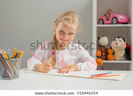 Young creative girl drawing
