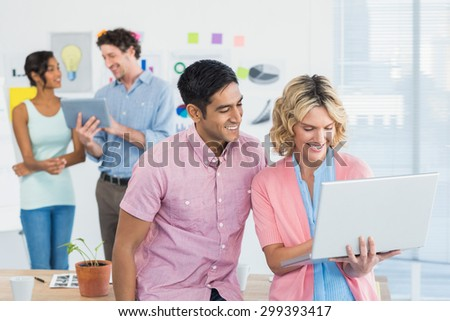 Young creative team people with laptop and digital tablet in office