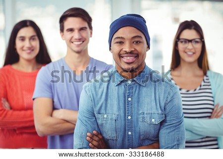 Young creative team smiling at camera in casual office