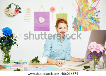 Young creative woman making images - stock photo