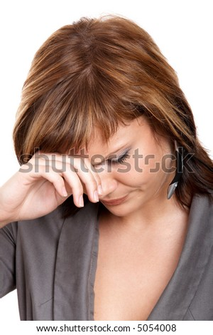 Young crying girl with a microphone isolated at the white background - stock photo