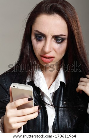 Young crying woman in depression drunk calling on cell phone - stock photo