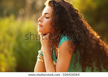 young curly hair woman enjoy in summer sun - stock photo