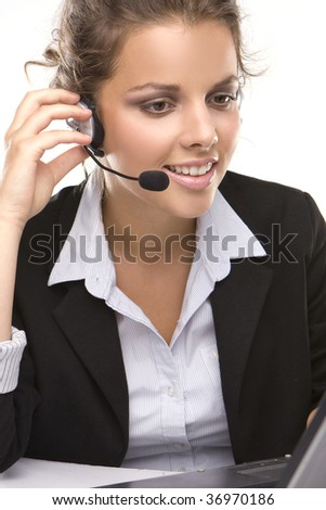 Young customer service adviser  with headphone on white background