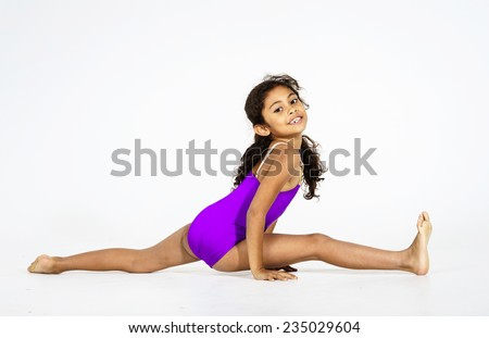 Young cute afro-american girl doing gymnastics isolated on white background - stock photo