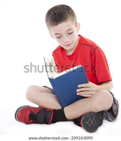 Young cute boy reading a book isolated on white backgrond - stock photo