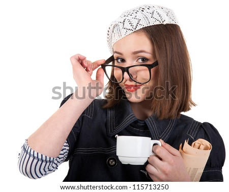 Young cute brunette girl in parisian style with cup of coffee and newspaper - stock photo