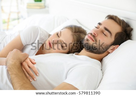 Young cute couple sleeping together in bed. Sleep Stock Images  Royalty Free Images   Vectors   Shutterstock