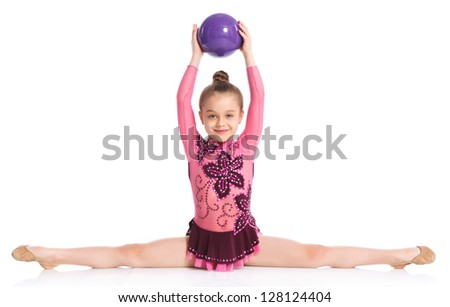 Young cute girl doing gymnastics with ball over white background - stock photo