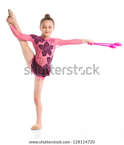 Young cute girl doing gymnastics with gymnastic mace over white background
