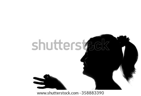 Young cute girl holding your product - black and white silhouette