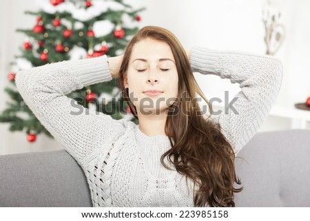 young cute girl is relaxing after busy christmas stress - stock photo