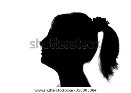 Young cute girl looking up - black and white silhouette of a side view - stock photo