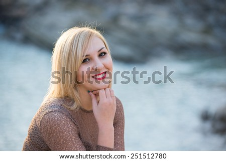 Young cute girl on walk in park - stock photo