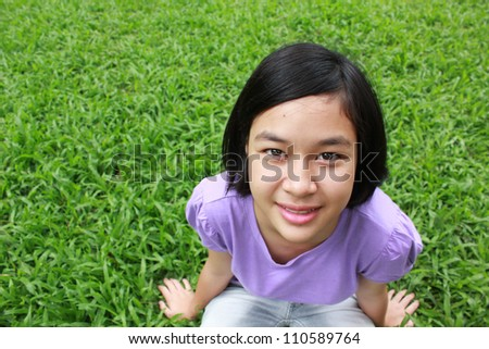 Young cute girl relaxing in the park. - stock photo