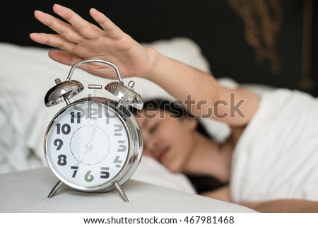 Young Cute Girl Stop Alarm Clock At Bedroom.