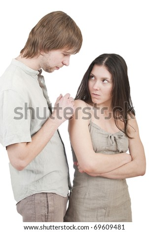 young cute guy asks his friend forgiveness - stock photo