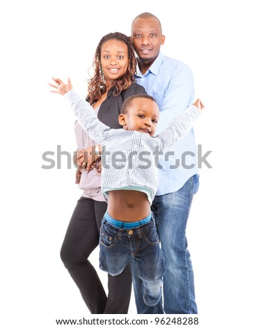 Young cute happy black family - with the son jumping in the front isolated over white background. - stock photo