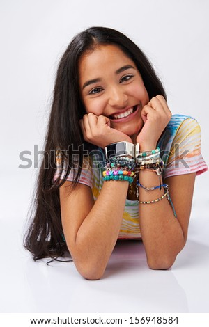 Young cute latin american girl smiling isolated on white background - stock photo