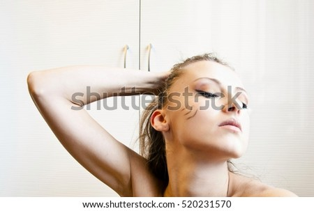 young cute sexy woman or girl with pocahontas ethnic tribal fashionable makeup on pretty face holding hair, portrait