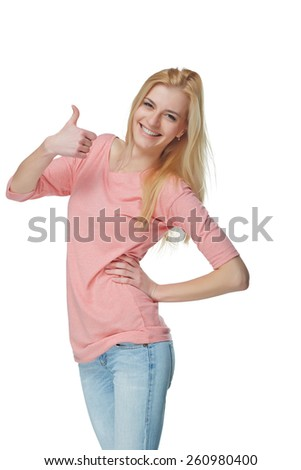 Young cute smiling emotional girl giving you thumb up, isolated on white - stock photo