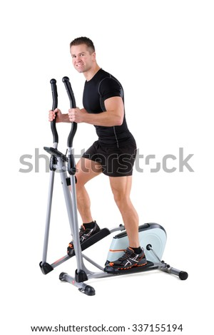 young cute sporty woman doing exercises with elliptical trainer, on white background - stock photo