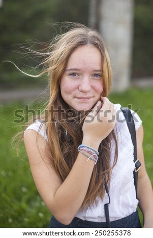 Young cute teen girl portrait outdoors. - stock photo