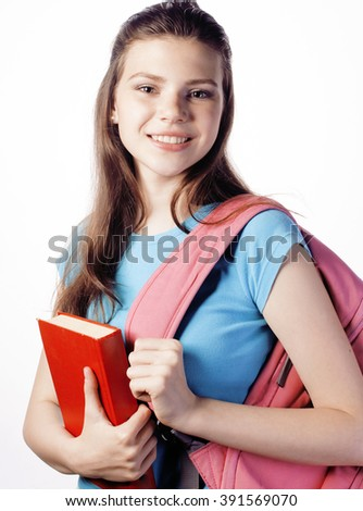 young cute teenage girl posing cheerful against white background with books and backpack