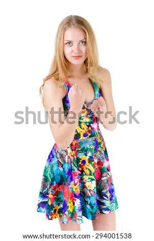 Young cute teenager blonde girl showing fists and ready to fight, isolated on white background, positive human emotion, facial expression - stock photo