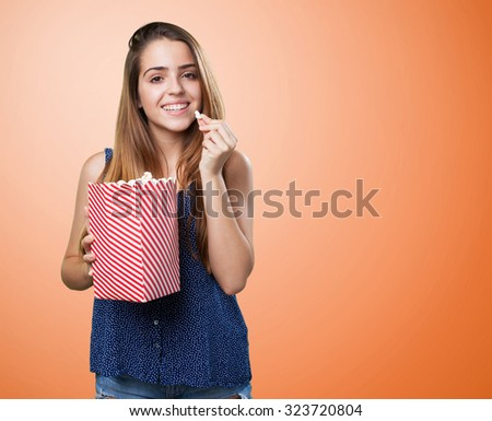 young cute woman eating popcorn - stock photo
