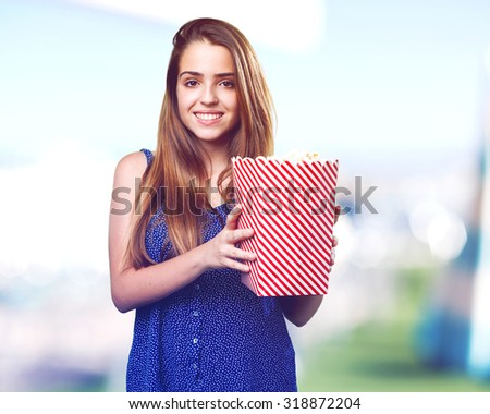 young cute woman holding popcorn - stock photo