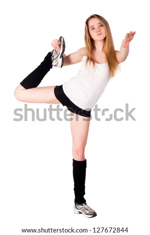 Young cute woman in sportswear show athletic skill. Isolated over white - stock photo
