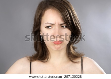 Young cute woman in upset mood
