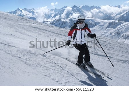 Young cute woman on the slope.Skiing. - stock photo