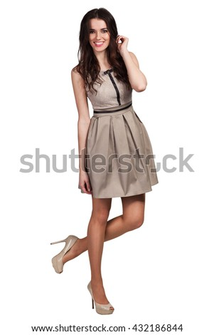 Young cute woman posing in dress on white background - stock photo