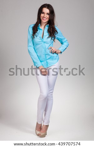 Young cute woman posing on white background