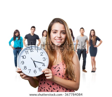 young cute woman smiling and holding a clock on white - stock photo