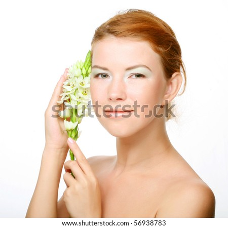 young cute woman with fresh white flower